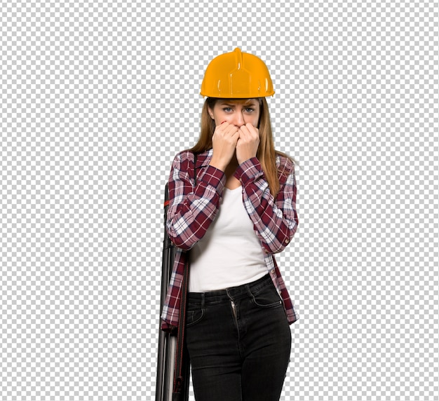 Architect woman nervous and scared putting hands to mouth