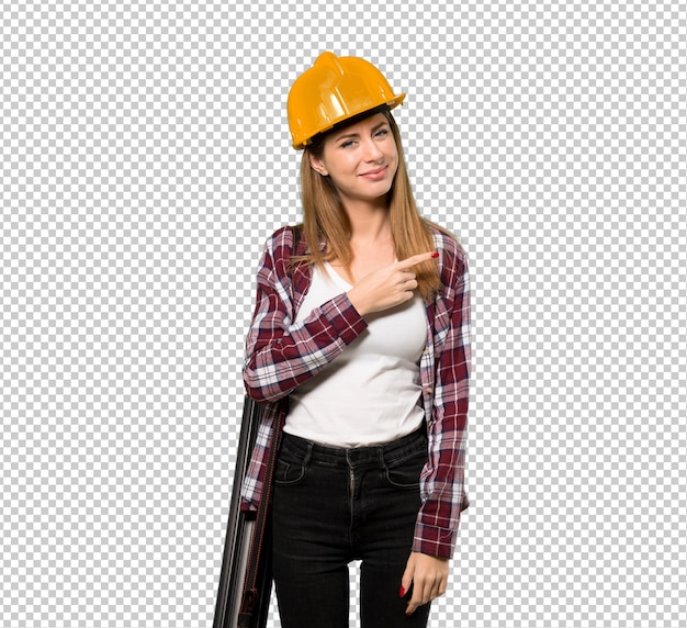Architect woman pointing to the side to present a product