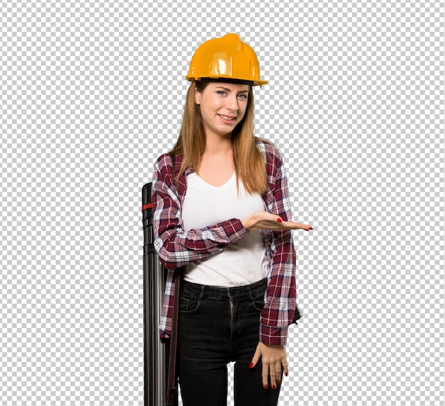 Architect woman presenting an idea while looking smiling towards
