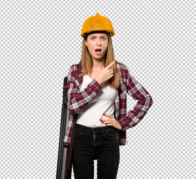 Architect woman surprised and pointing side