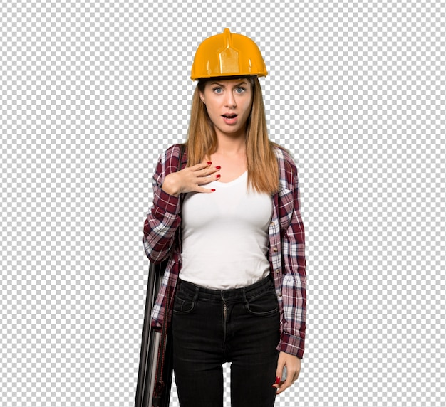 Architect woman surprised and shocked while looking right
