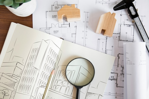 Architecture composition with paper mockup and magnifying glass