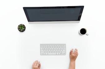 Ariel view of hands using a desktop computer