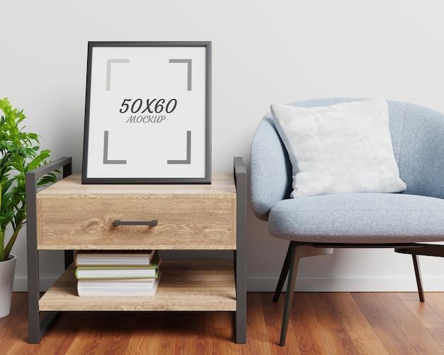 Кресло деревянный стол и пустая рамка в гостиной 3d-рендеринга