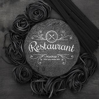 Arrangement of dark spaghetti mock-up