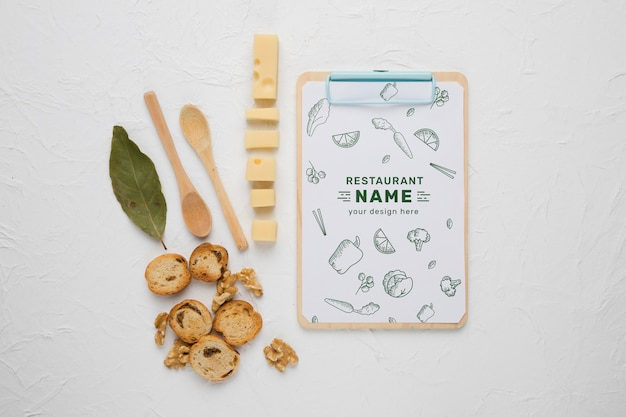Arrangement of delicious foods with clipboard mock-up
