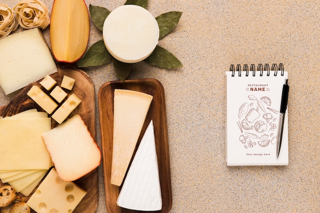 Arrangement of delicious foods with notepad mock-up