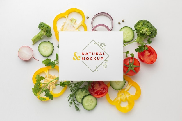 Arrangement of delicious vegetables with mock-up card