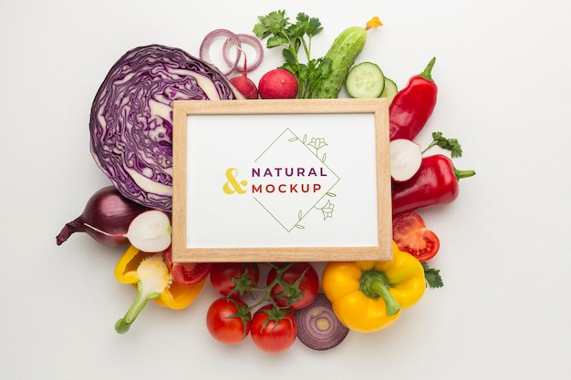 Arrangement of delicious vegetables with mock-up frame