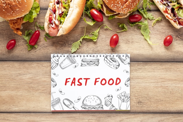 Arrangement of fast food mock-up on wooden table