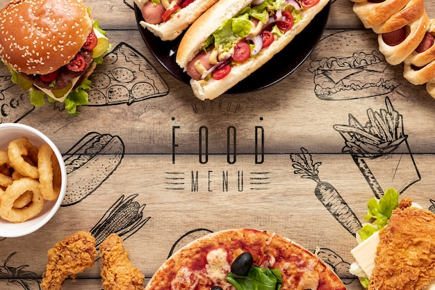 Arrangement of fast food on wooden background