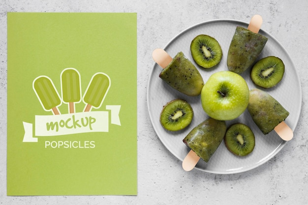 Arrangement of fresh popsicles with mock-up card