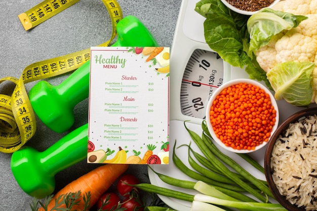 Arrangement of healthy food on scale and diet menu
