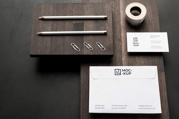 Arrangement of mock-up stationery on wood