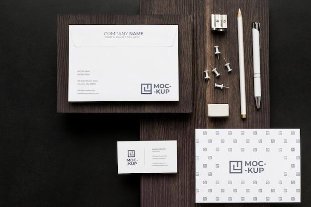 Arrangement of mock-up stationery on wood Free Psd