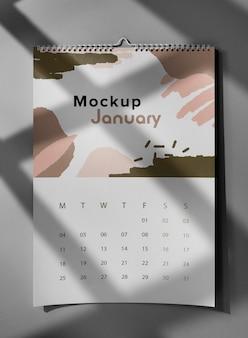 Arrangement of mock-up wall calendar indoors