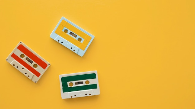 Arrangement of music cassettes on yellow background