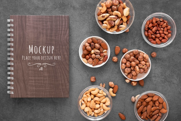 Arrangement of nuts with notebook mock-up