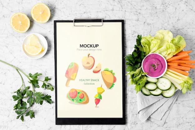 Arrangement of snacks with clipboard mock-up