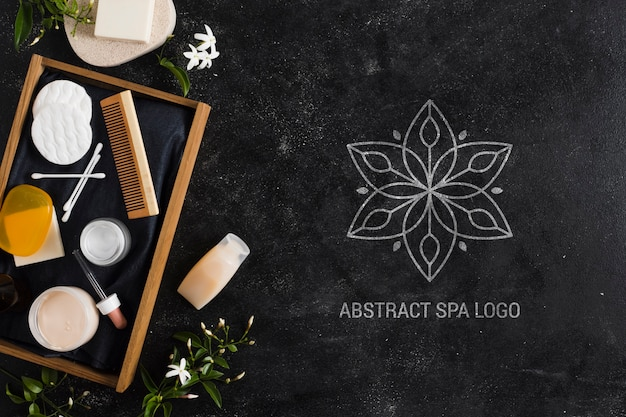Arrangement with abstract spa salon logo
