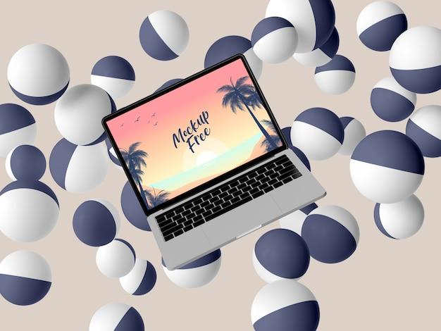 Disposizione con laptop e palline Psd Gratuite