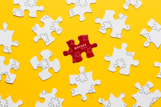 Arrangement with puzzle pieces on yellow background