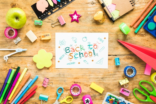 Arrangement with supplies for school on wooden background