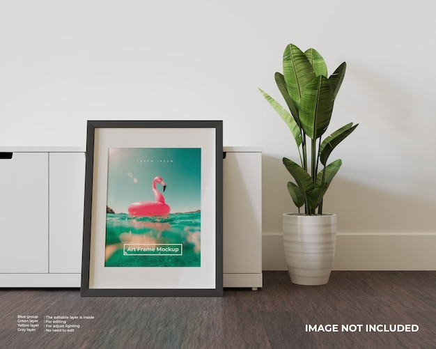 Art frame poster mockup leaning against the white cupboard