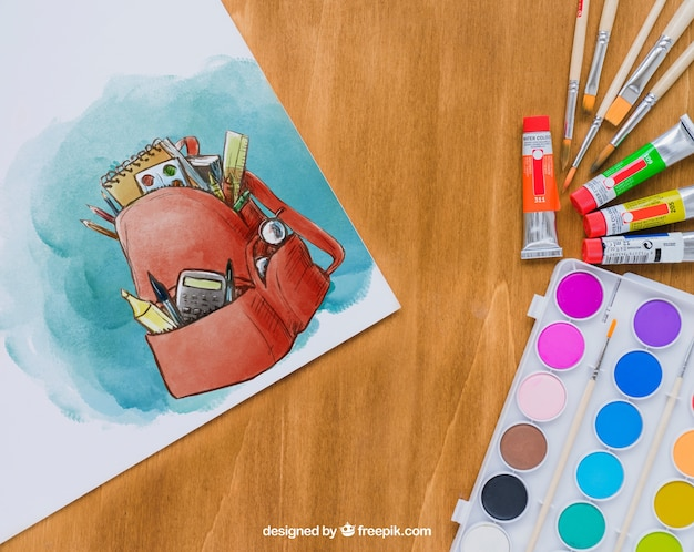 Art lessons' materials with watercolor drawing