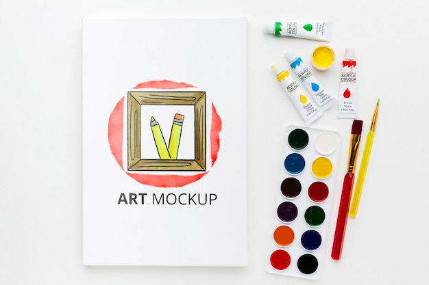 Art mock-up with watercolors flat lay