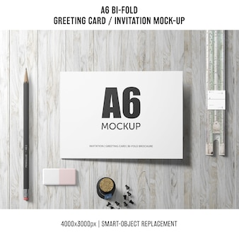 Artistic a6 bi-fold invitation card mockup