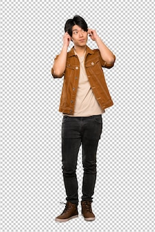 Asian man with brown jacket having doubts and thinking