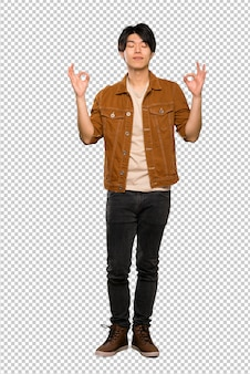 Asian man with brown jacket in zen pose
