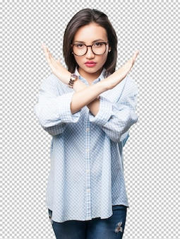 Asian woman doing cross gesture