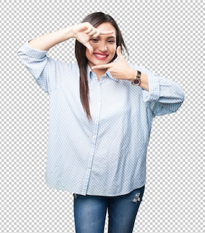 Asian woman doing frame gesture