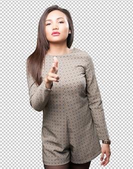 Asian woman doing gun gesture