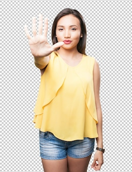 Asian woman doing number five gesture