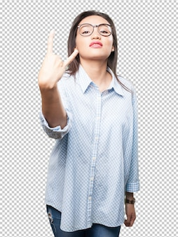 Asian woman doing rock gesture