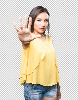 Asian woman doing stop gesture