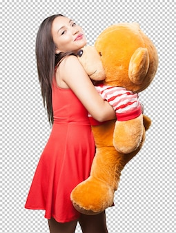 Asian woman holding a teddy bear