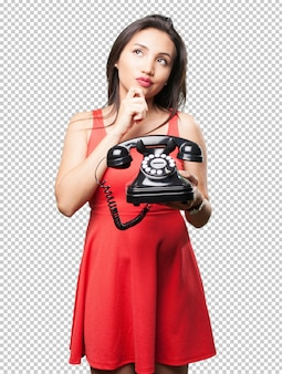 Asian woman holding a telephone