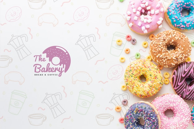 Assortment of colorful donuts with mock-up
