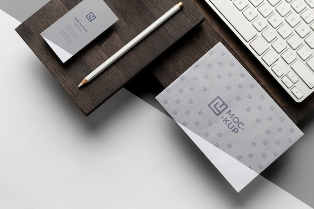 Assortment of mock-up stationery on wood Free Psd