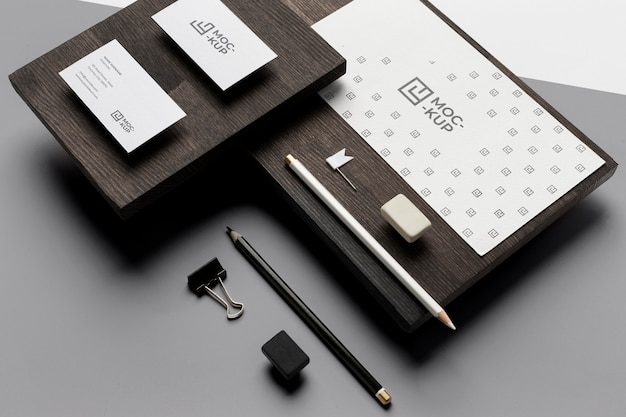 Assortment of mock-up stationery on wood