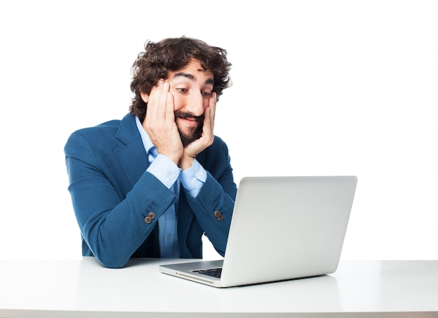 Astonished employee looking at his laptop