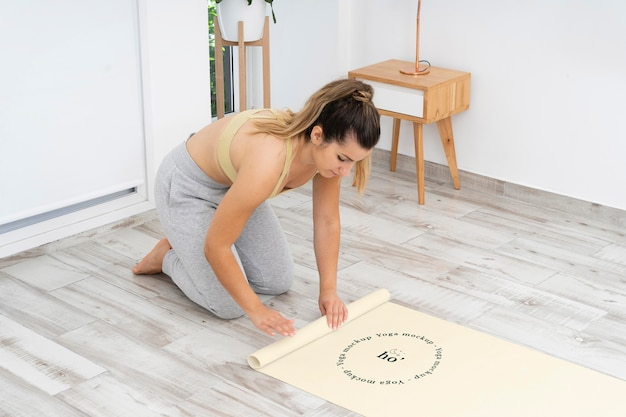 Athletic woman doing yoga at home
