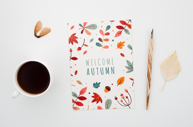 Autumn card next to card and coffee