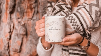 Autumn concept with woman holding mug