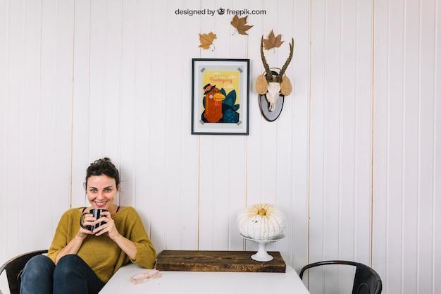 Autumn mockup with woman holding mug
