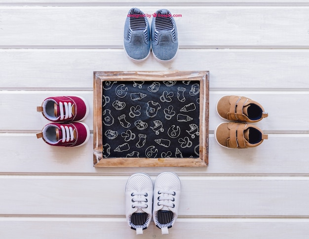 Baby mockup with four pairs of shoes